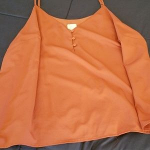 Coral blouse.